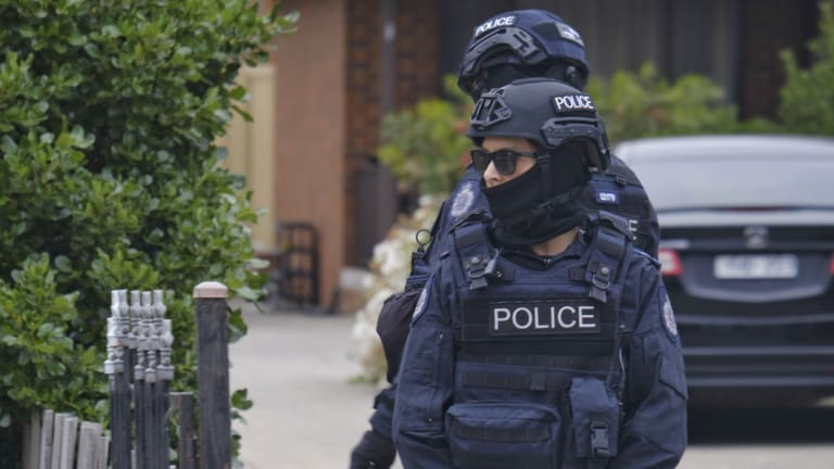 Police guard the house of a suspect terrorist in Dallas on Tuesday