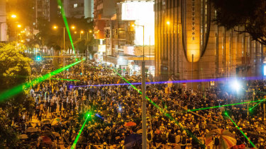 Pro-democracy protesters shine laser pointers during a clash at Admiralty district in Hong Kong.