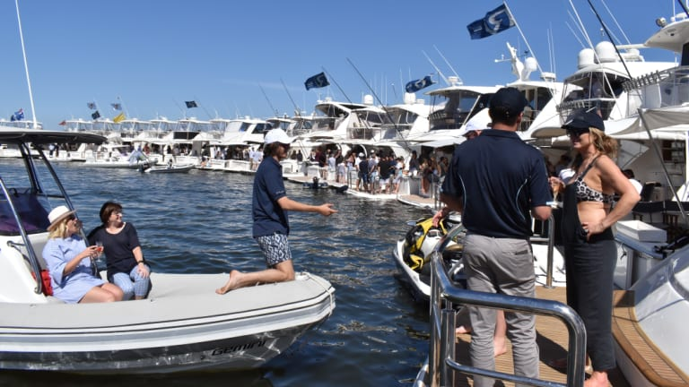 Over 43 luxury motor yacht owners and their families congregated on boats to try and break their previous world record of 48 boats rafted up.