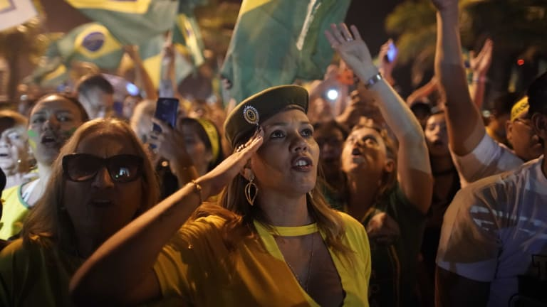 Supporters of Jair Bolsonaro celebrate in front of his residence in Rio.