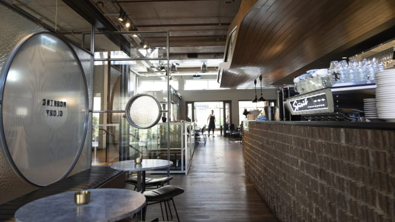 It's a beautiful space, dark tones of timber, stone and steel, but lit, even in early Spring, by the light pouring through the large glass windows and doors at either end.