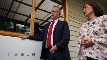 Opposition Leader Bill Shorten, with Victorian state Energy Minister Lily D'Ambrosio, out selling his energy policy in Brunswick on Friday.