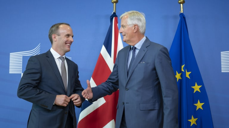 Dominic Raab, the UK Brexit secretary, left and Michel Barnier, chief negotiator for the European Union), shake hands following a news conference in Brussels, Belgium, on Friday.
