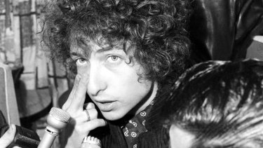 Singer Bob Dylan speaks to reporters at Sydney's Mascot Airport on 12 April 1966.