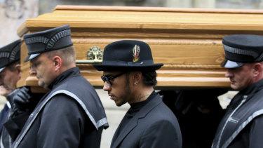 Lewis Hamilton (centre) attend the funeral.