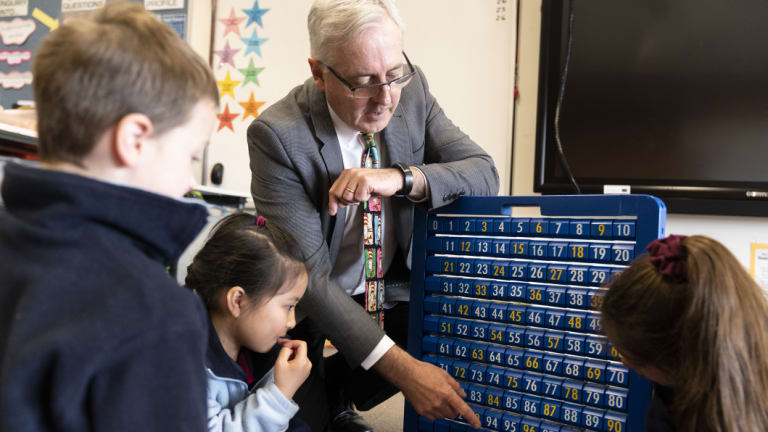 Radford College maths teacher Bruce Ferrington looks for patterns with Ryder Brede (left), Joanna Ky and Chloe Maglasis.