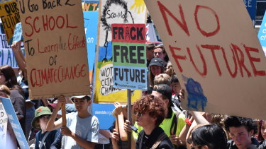 Students protest government inaction on climate change at WA Parliament House on Friday afternoon.
