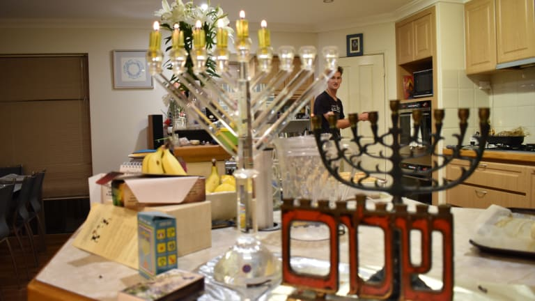 "The Chernys consider lighting the candelabrum the most important part of Hanukkah as it symbolises ushering in ""light."""