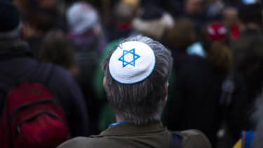 A man wears a Jewish skullcap as he attends a demonstration against an anti-Semitic attack  in Berlin in April.