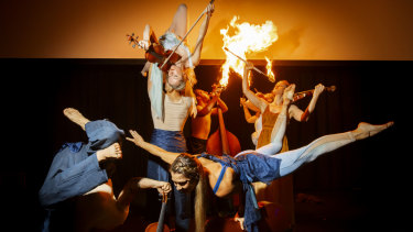 Members of the Freestyle Orchestra have a red-hot go.