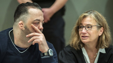 Former nurse Niels Hoegel, left, accused of multiple murder and attempted murder of patients, talks to his lawyer Ulrike Baumann.