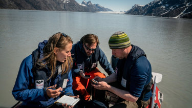 Mette Bendixen, David Blockley and Mikkel Bojesen collect sediment samples a few miles up the Sermilik Fjord in southwestern Greenland.