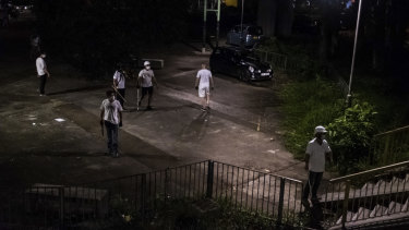 Men armed with sticks and poles outside a train station in Yuen Long, a Hong Kong border town, July 21.