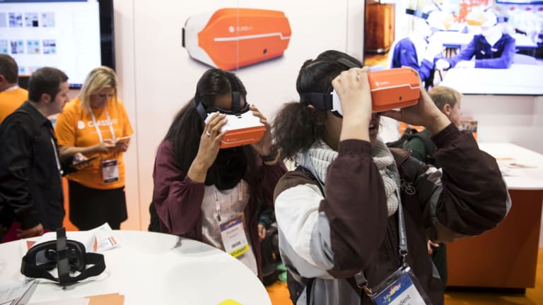 Making learning fun: Young students get to grips with virtual reality teaching aids at the EduTECH education trade fair.