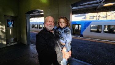Tim Haslett and his grandson Winton, whose arm was caught in a train door.