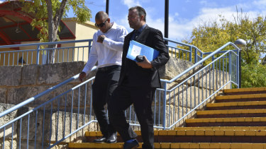 Mark Musa Bhatti (left) leaving court with his lawyer on Wednesday