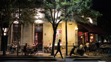 Customers sit outside of a restaurant at night in Buenos Aires, Argentina, on Wednesday, Jan 30, 2019. Argentina's capital typically witnesses a mass exodus when South American summer starts in late December. But with the economy inrecession, a currency that lost half of its value since May, and salaries that can't keep up with inflation, many have scrapped travel plans. Photographer: Erica Canepa/Bloomberg