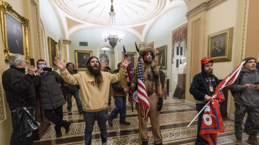 Supporters of President Donald Trump are confronted by U.S. Capitol Police officers