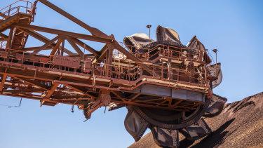 A reclaimer at the ore stockpile at the BHP Jimblebar facility in the Pilbara region of Western Australia.