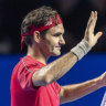 Home-town hero Roger Federer salutes the crowd after his victory.