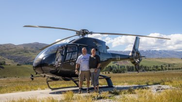 Jolanda Foale and her partner Richard with the helicopter they fly over scenic Queenstown and the surrounding region.