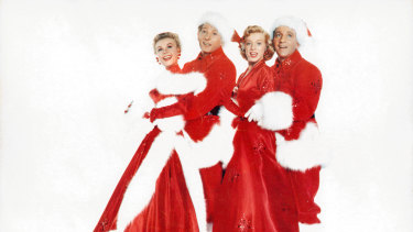 Vera-Ellen, Danny Kaye, Rosemary Clooney and Bing Crosby in a scene from White Christmas.