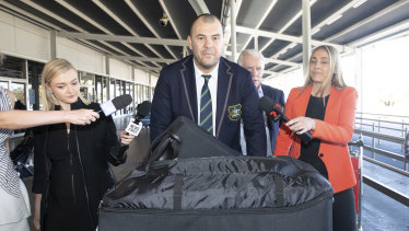Cheika arrives at Sydney airport to be greeted by a sizeable press pack on Tuesday.