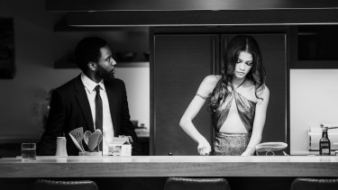 Making do: John David Washington's suits were fitted by his producer sister; co-star Zendaya (right) brought her own outfits.