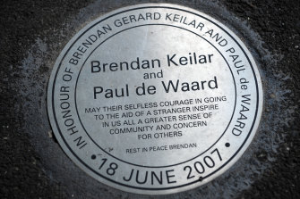 The plaque on the corner of William Street and Flinders Lane paying tribute to the heroism of Brendan Keilar, who lost his life, and Paul de Waard.