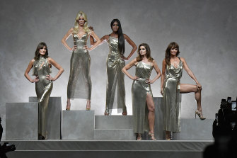Carla Bruni, Claudia Schiffer, Naomi Campbell, Cindy Crawford, Helena Christensen walk the runway at the Versace Ready to Wear Spring/Summer 2018 fashion show.