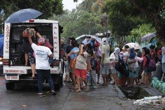Residents evacuate ahead of Typhoon Kammuri in Legazpi, Albay, Philippines.