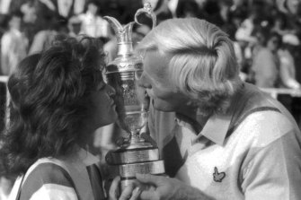 British Open winner Greg Norman and wife, Laura, kiss the trophy.