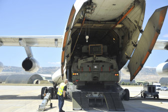 Parts of the S-400 air defence system are unloaded from a Russian plane at Murted military airport near Ankara, Turkey.