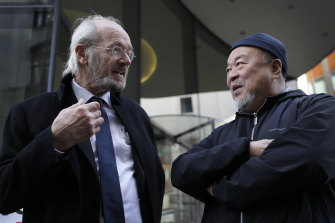 Julian Assange's father John Shipton with Chinese contemporary artist and activist Ai Weiwei, outside the Old Bailey in London.