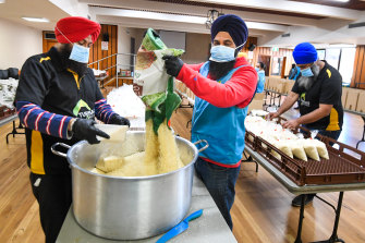 Turbans 4 Australia pack hundreds of hampers in local halls in Harris Park and Liverpool each weekend.