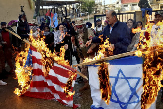 Burning of US, Israeli and British flags has occurred regularly throughout Middle East protests, like this one in Lebanon, since the US assassination of Iranian General Qassem Soleimani.