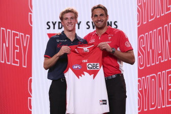 Dylan Stephens stands next to Swans veteran Josh Kennedy after being picked up by the Swans.