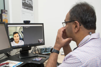 Dr Mukesh Haikerwal interviewing patient James via phone link before the test.