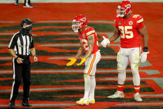 Tyrann Mathieu of the Kansas City Chiefs speaks with back judge Dino Paganelli following a pass interference call.