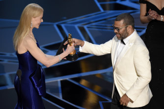Nicole Kidman, left, presenting Jordan Peele with the award for best original screenplay for Get Out