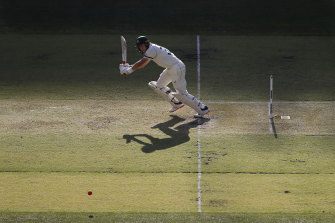Too good: Marnus Labuschagne clips one through the leg side as shadows stretch across the Optus Stadium surface.