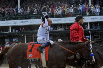 Jockey Mike Smith smiles after the Kentucky Derby victory on Justify in 2018.