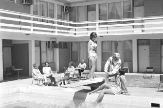 "Alice Springs, 1970:  ""A man kicks back in a freshly ironed pair of slacks, while a woman in a bikini wonders why he's wearing a jumper,"" notes Tim Ross."