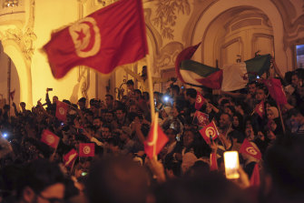 A crowd gathers on Tunis' main avenue on Sunday to celebrate Kais Saied's election.