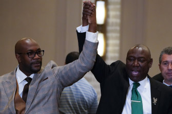 George Floyd's brother Philonise Floyd and Attorney Ben Crump, from left, react after a guilty verdict was announced at the trial of former Minneapolis police officer Derek Chauvin.