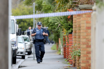 Police on the scene in Kew after Elizabeth Wilms' body was found.