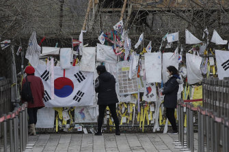 Business as usual. Visitors near the border between North and South Korea add to messages and flags of re-unification hope. There is still no official word on Kim's health.