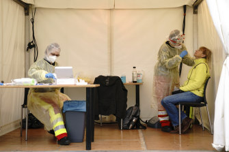 A woman is tested for COVID-19 in amobile testing site in Berlin, Germany this week.