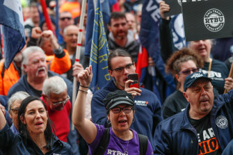 Rail, Tram and Bus Union members rally in the city.