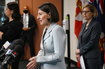 Premier Gladys Berejiklian, with Chief Health Officer Kerry Chant (right), announced a relaxation of COVID-19 restrictions on Monday.